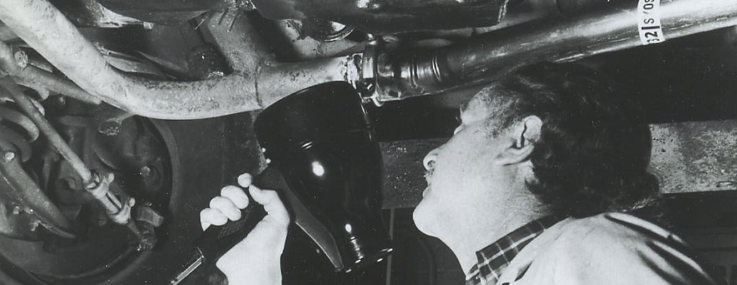 Bill Cooper Inspecting an Automobile